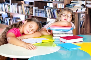 bigstock-Kids-asleep-in-a-school-librar-42185986